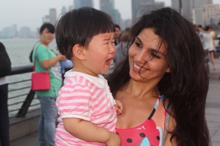 Juxtaposing tourist emotions on the Bund. Shanghai, China