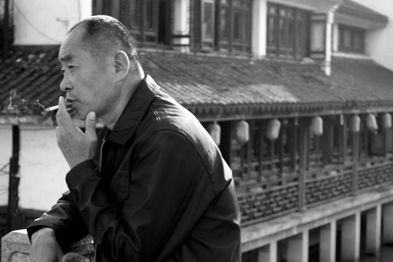 Reflective smoking. Qibao, China